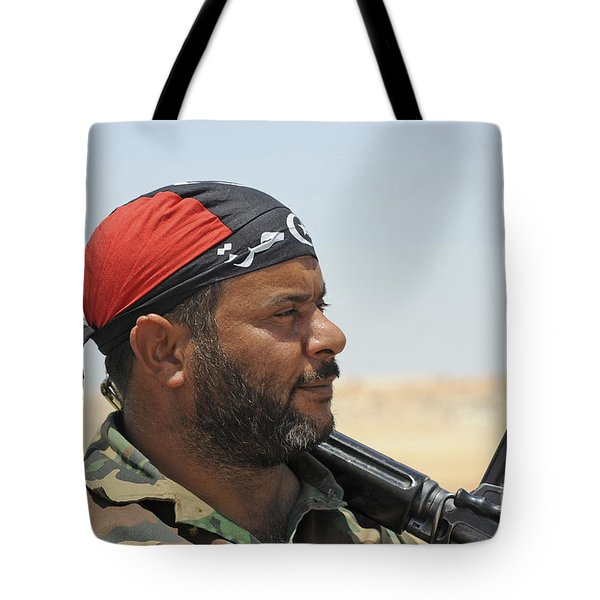 A Rebel Fighter Armed With A Fn Fal Tote Bag by Andrew Chittock