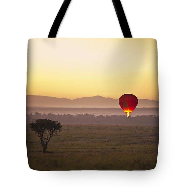 A Red Hot Air Balloon Takes Flight Tote Bag by David DuChemin