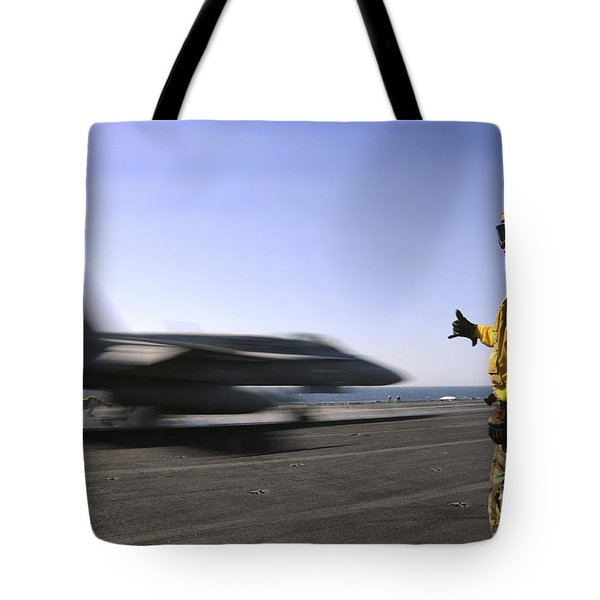 A Sailor Ensures An Fa-18c Hornet Tote Bag by Stocktrek Images