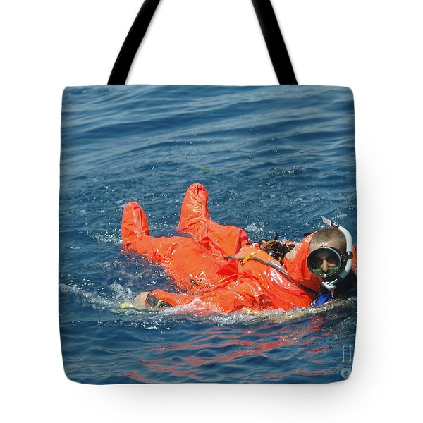 A Sailor Rescued By A Diver Tote Bag by Stocktrek Images
