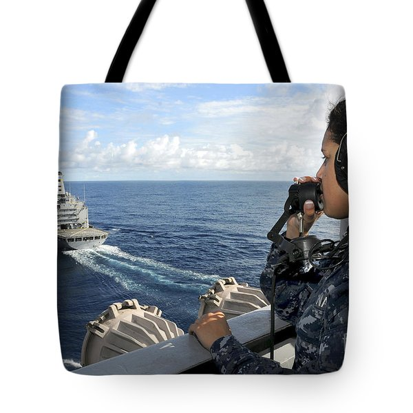 A Sailor Stands Forward Lookout Watch Tote Bag by Stocktrek Images
