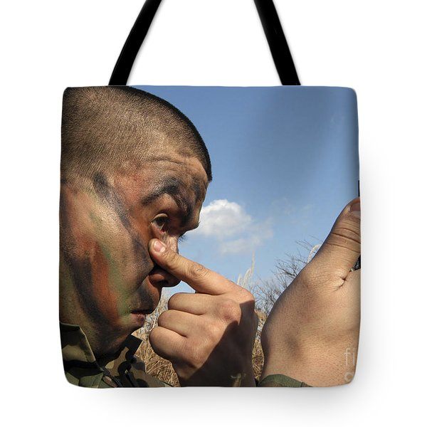 A Soldier Applying Face Paint Prior Tote Bag by Stocktrek Images