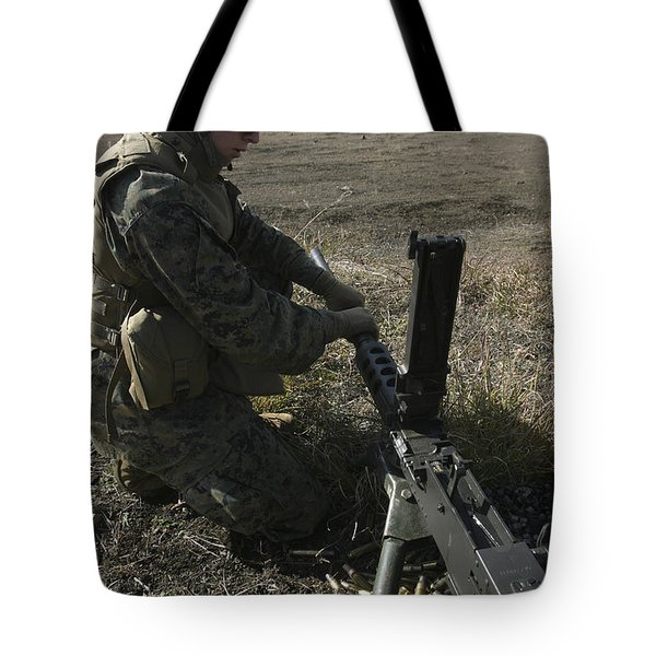 A Soldier Changes The Barrel Of An M2 Tote Bag by Stocktrek Images
