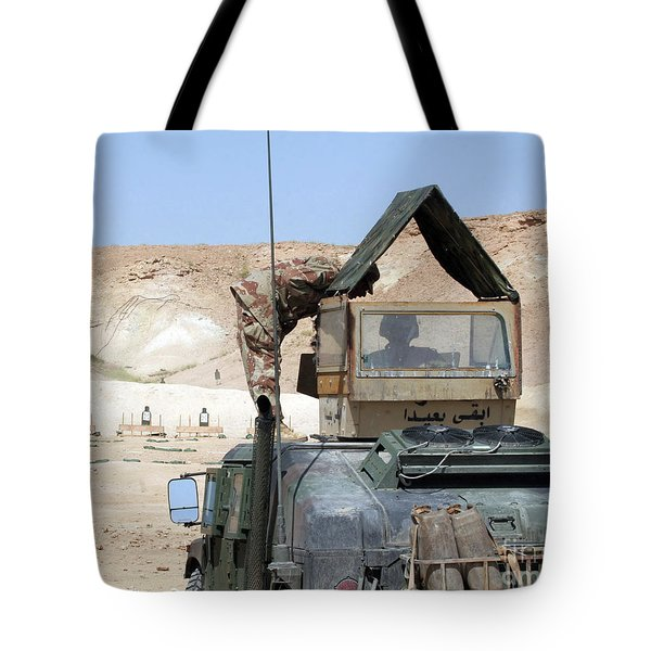 A Soldiier Instructs An Iraqi Army Tote Bag by Stocktrek Images