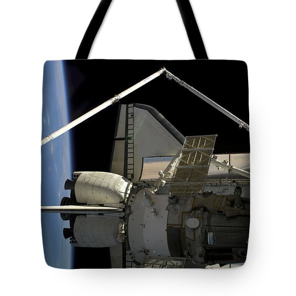 A Soyuz Vehicle And The Space Shuttle Tote Bag by Stocktrek Images