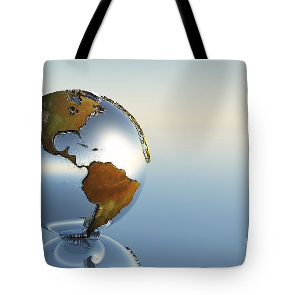 A Sphere Holding North And South Tote Bag by Corey Ford