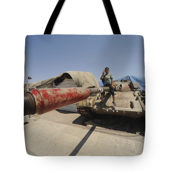 A T-55 Tank With Two Children Playing Tote Bag by Andrew Chittock
