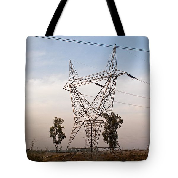 Tote Bag featuring the photograph A Transmission Tower Carrying Electric Lines In The Countryside by Ashish Agarwal