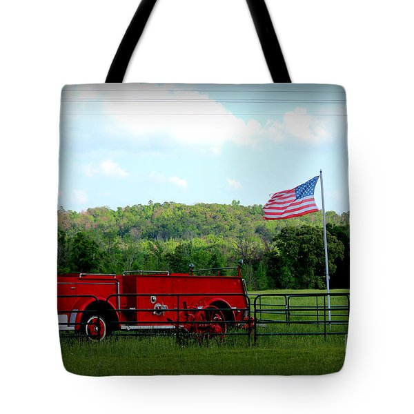 Tote Bag featuring the photograph A Tribute To The Fireman by Kathy  White