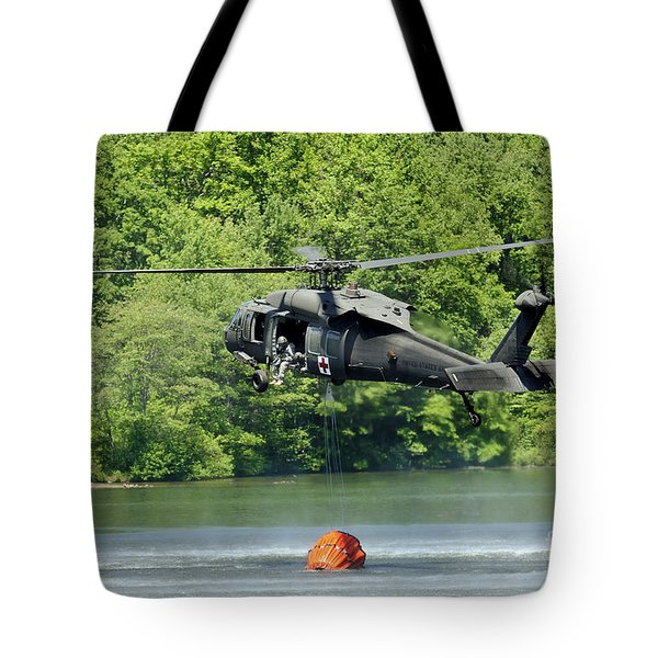 A Uh-60 Blackhawk Helicopter Fills Tote Bag by Stocktrek Images