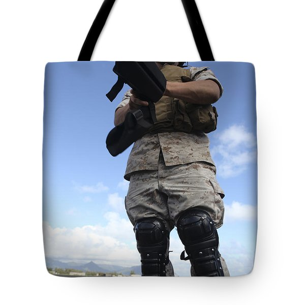 A U.s. Marine Dons Riot Gear For Drills Tote Bag by Stocktrek Images