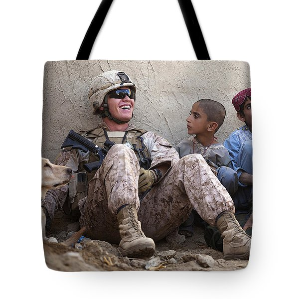 A U.s. Marine Jokes With Afghan Tote Bag by Stocktrek Images