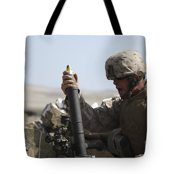 A U.s. Marine Loads A Mortar Tote Bag by Stocktrek Images