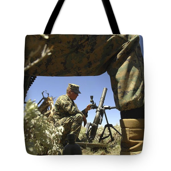 A U.s. Marine Mortarman Trains On An Tote Bag by Stocktrek Images