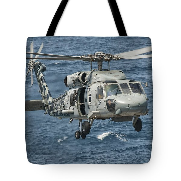 A Us Navy Sh-60f Seahawk Flying Tote Bag by Giovanni Colla