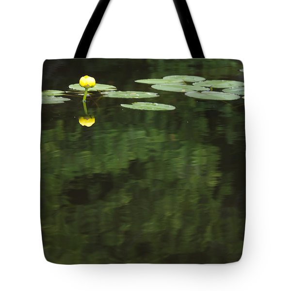 A Water Lily Is Reflected Tote Bag