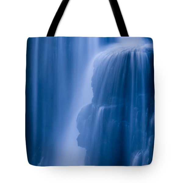 A Waterfall Splashes Off Of A Large Tote Bag