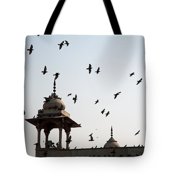 Tote Bag featuring the photograph A Whole Flock Of Pigeons On The Top Of The Ramparts Of The Red Fort In New Delhi by Ashish Agarwal