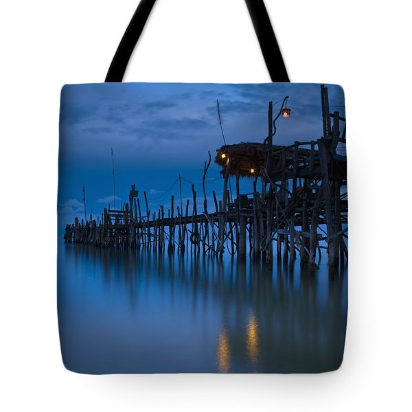 A Wooden Pier With Lights On It At Tote Bag by David DuChemin