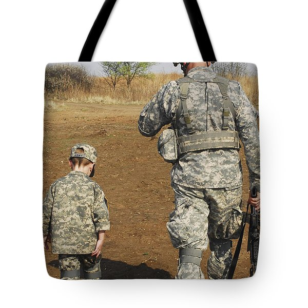 A Young Boy Joins His Squad Leader Tote Bag by Stocktrek Images