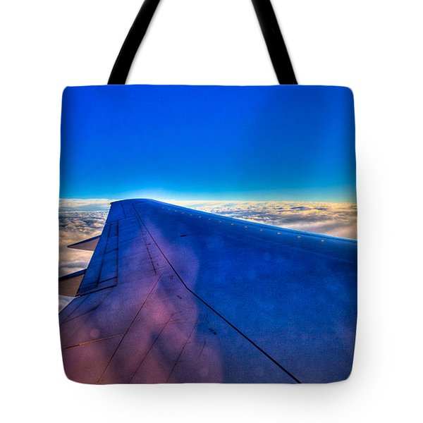 Above The Clouds On A 757 Tote Bag by David Patterson