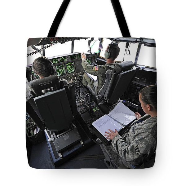 Aircrew Perform Preflight Checklists Tote Bag by Stocktrek Images