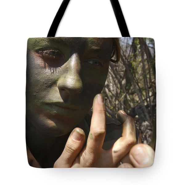 Airman Applies Camouflage Paint Tote Bag by Stocktrek Images
