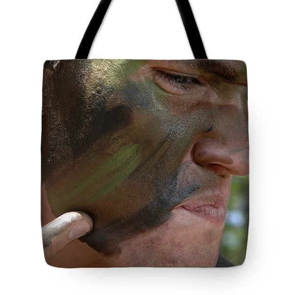 Airman Applies War Paint To His Face Tote Bag by Stocktrek Images