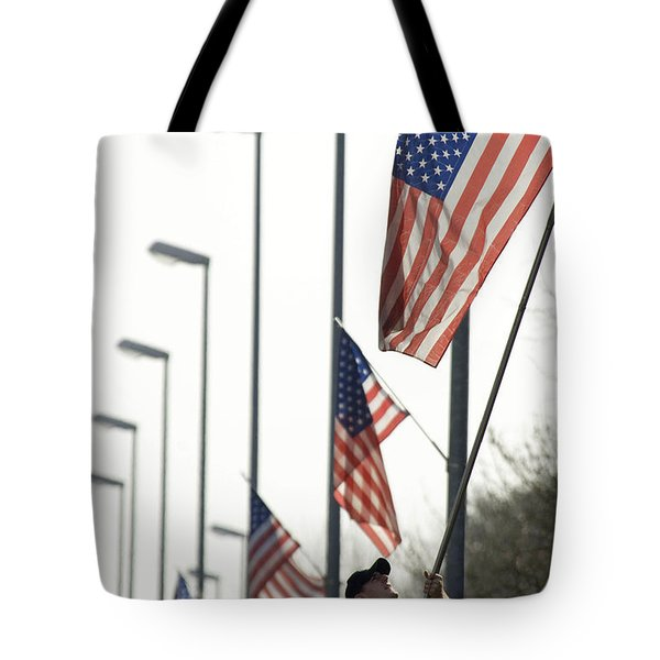 Airman Posts A New Flag On The Main Tote Bag by Stocktrek Images
