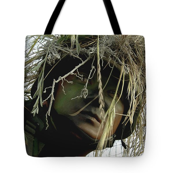 Airman Wearing A Ghillie Suit Tote Bag by Stocktrek Images