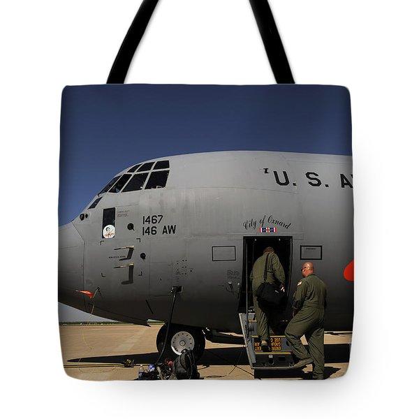 Airmen Board A C-130j Hercules At Dyess Tote Bag by Stocktrek Images