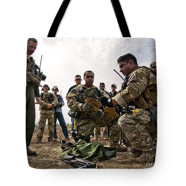 Airmen Explain Their Evidence Gathering Tote Bag by Stocktrek Images