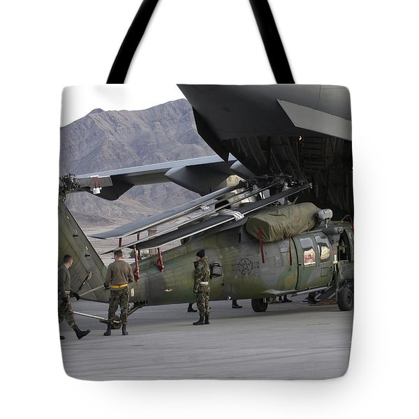 Airmen Load An Hh-60 Pave Hawk Tote Bag by Stocktrek Images
