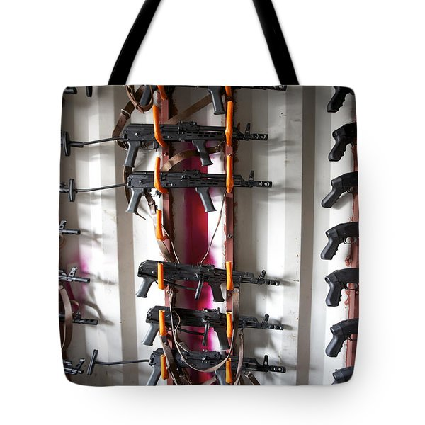 Akm Assault Rifles Lined Up On The Wall Tote Bag by Terry Moore