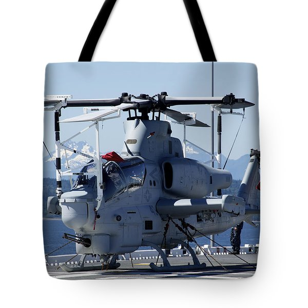 An Ah-1w Cobra Is Chained To The Flight Tote Bag by Stocktrek Images