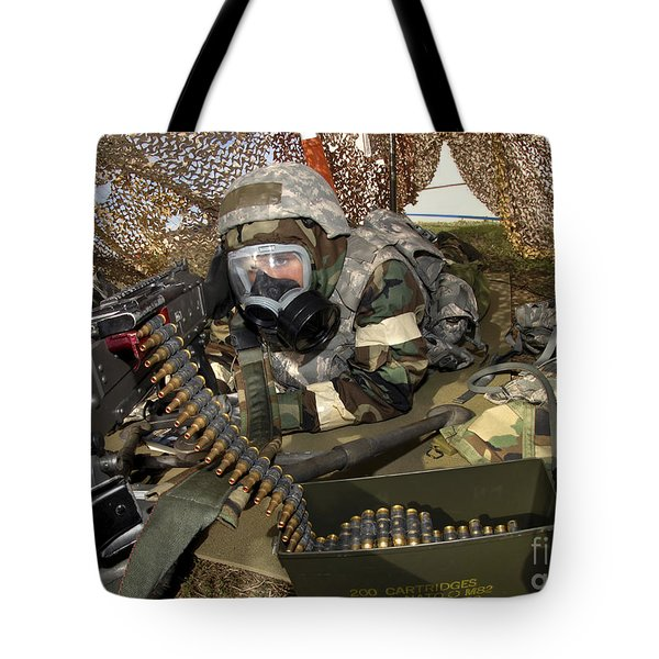 An Airman Defends Her Position Firing Tote Bag by Stocktrek Images