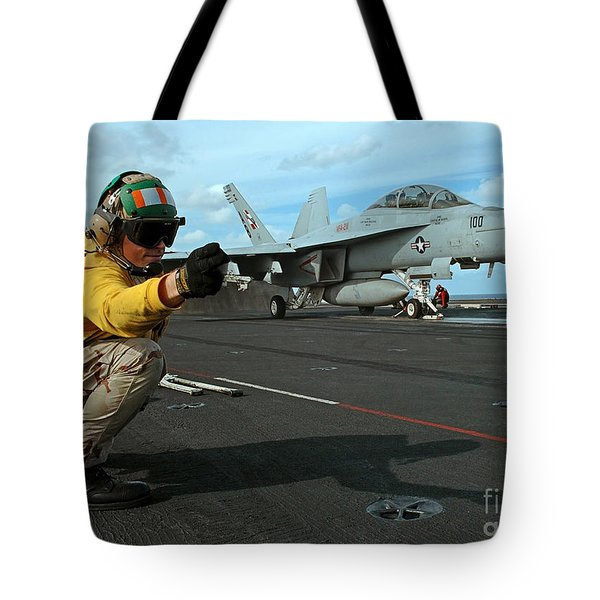 An Airman Gives The Signal To Launch An Tote Bag by Stocktrek Images