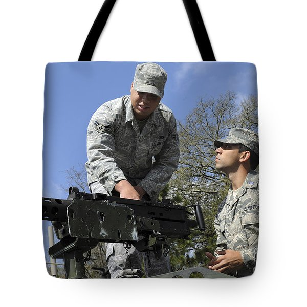 An Airman Instructs A Cadet On How Tote Bag by Stocktrek Images