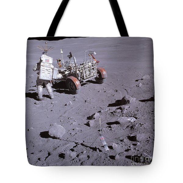 An Astronaut And A Lunar Roving Vehicle Tote Bag by Stocktrek Images