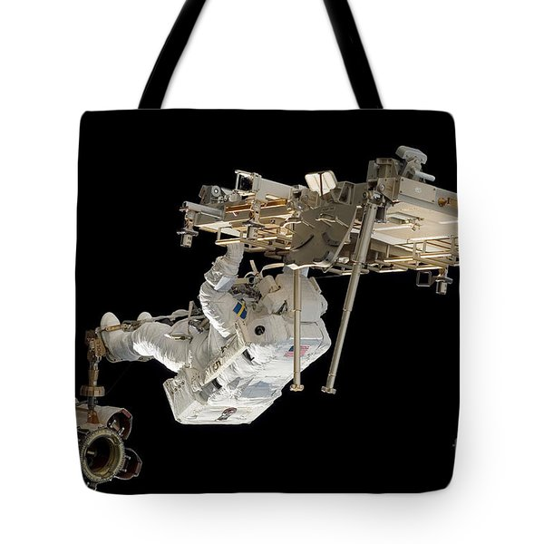 An Astronaut With His Feet Secured Tote Bag by Stocktrek Images