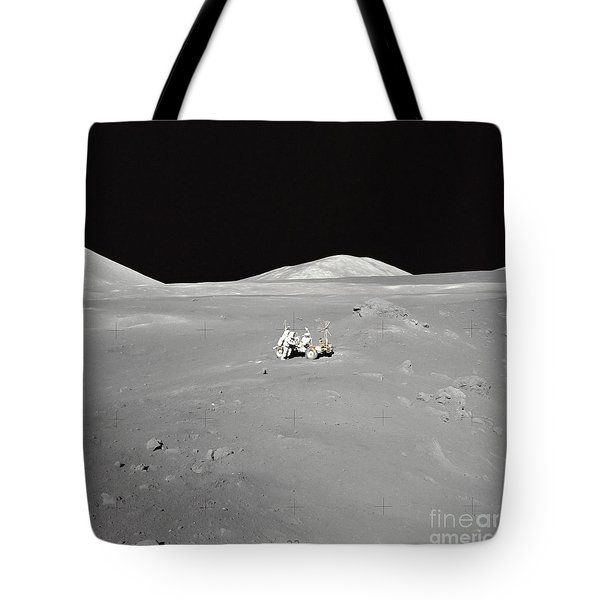 An Astronaut Working At The Lunar Tote Bag by Stocktrek Images