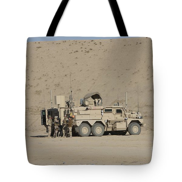 An Eod Cougar Mrap In A Wadi Tote Bag by Terry Moore