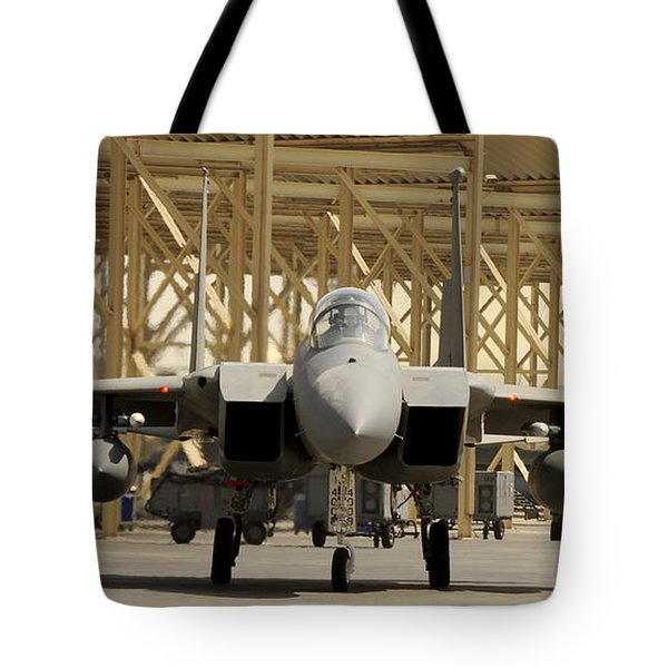 An F-15 Eagle Taxis Prior To A Training Tote Bag by Stocktrek Images