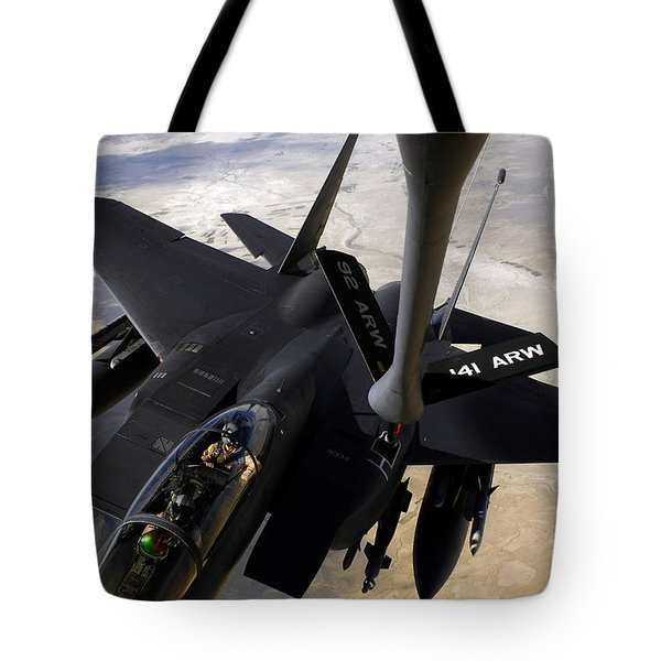 An F-15e Strike Eagle Aircraft Receives Tote Bag by Stocktrek Images