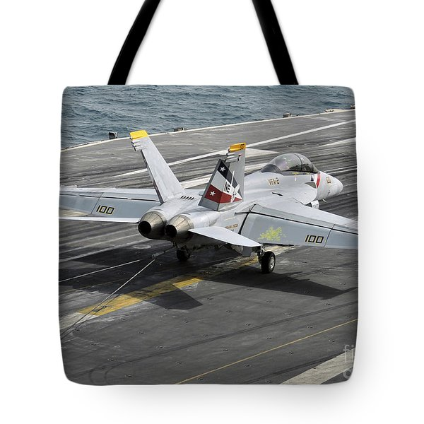 An Fa-18f Super Hornet Traps An Tote Bag by Stocktrek Images