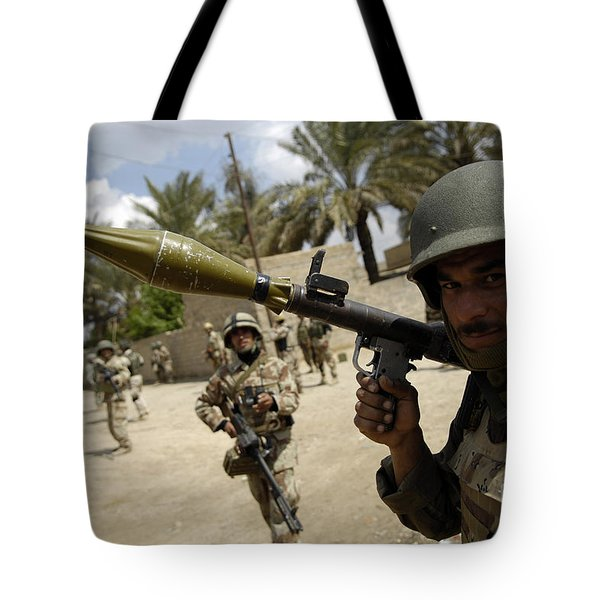 An Iraqi Army Soldier Provides Security Tote Bag by Stocktrek Images