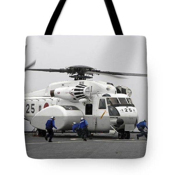 An Mh-53e Super Stallion Helicopter Tote Bag by Stocktrek Images