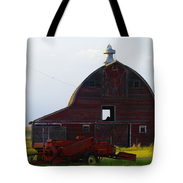 an old barn and bailor in Eastern Montana Tote Bag by Jeff Swan