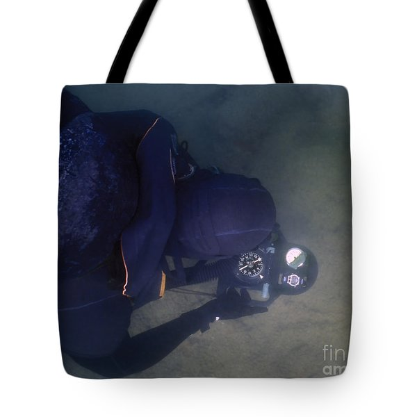 An Over The Shoulder View Of A Navy Tote Bag by Michael Wood