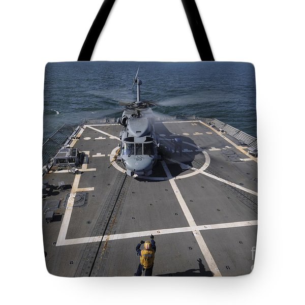An Sh-60b Sea Hawk Lands On The Flight Tote Bag by Stocktrek Images